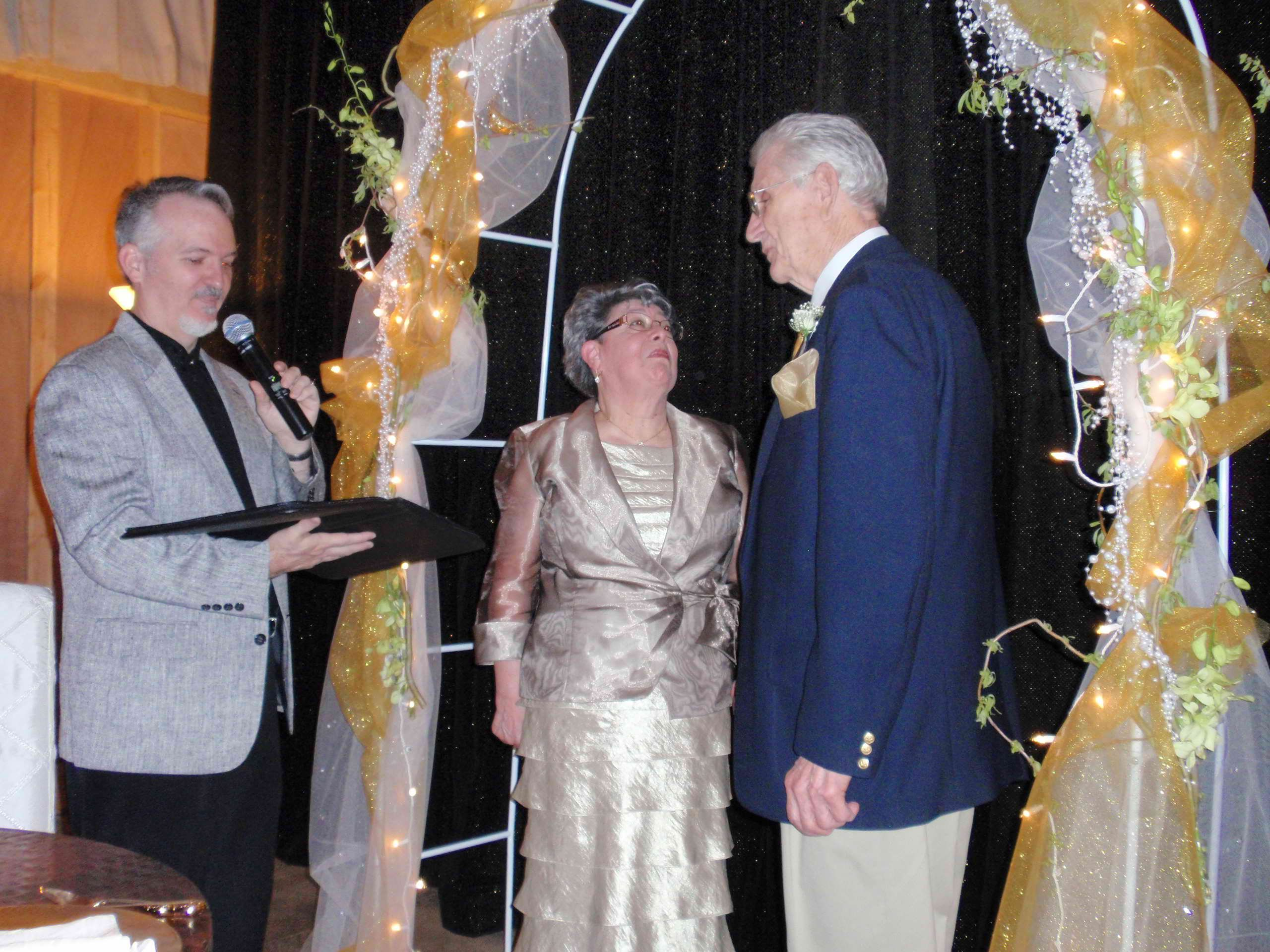 We purchased an inexpensive arch and my brother-in-law made stands to make it free-standing.  Mom and Dad did not know they would be renewing their vows.  The pastor is George Parker from Penn Valley, CA. He was personable and loving with a great sense of humor!