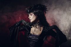 Romantic gothic girl in Victorian style clothes Royalty Free Stock Image
