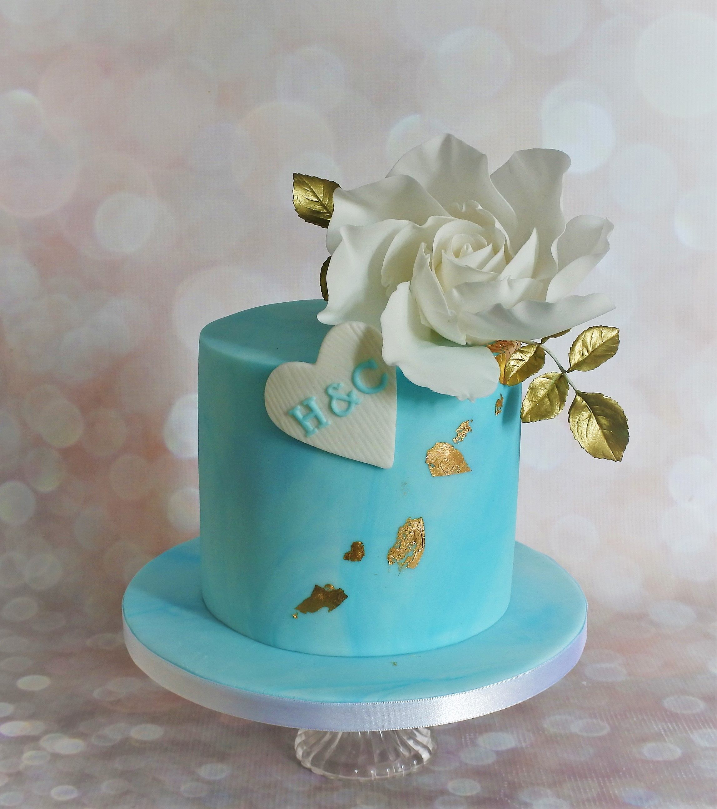 1 Tier Blue Marbled Wedding Cake With Edible Gold Leaf Large White Sugar Rose And Gold Leaves Simple Birthday Cake Simple Wedding Cake Cake
