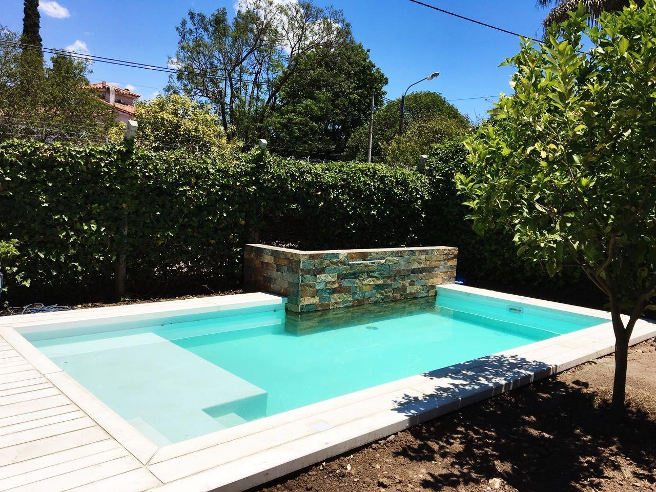 Piscina scualo piscina familiar tendencia wellness for Piscinas jardin cordoba