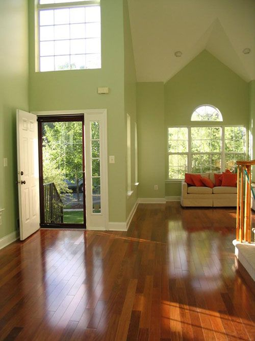 charming light green living room wall color | Light green walls and high, open ceilings balanced by ...
