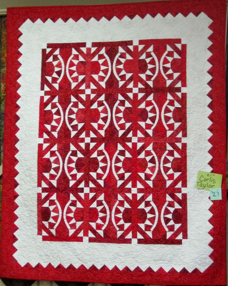 Red and white quilt by Corlis Taylor (Alaska), made with 25 different red fabrics, with a really unusual pieced arc.  Posted by Sue Ann Bowling