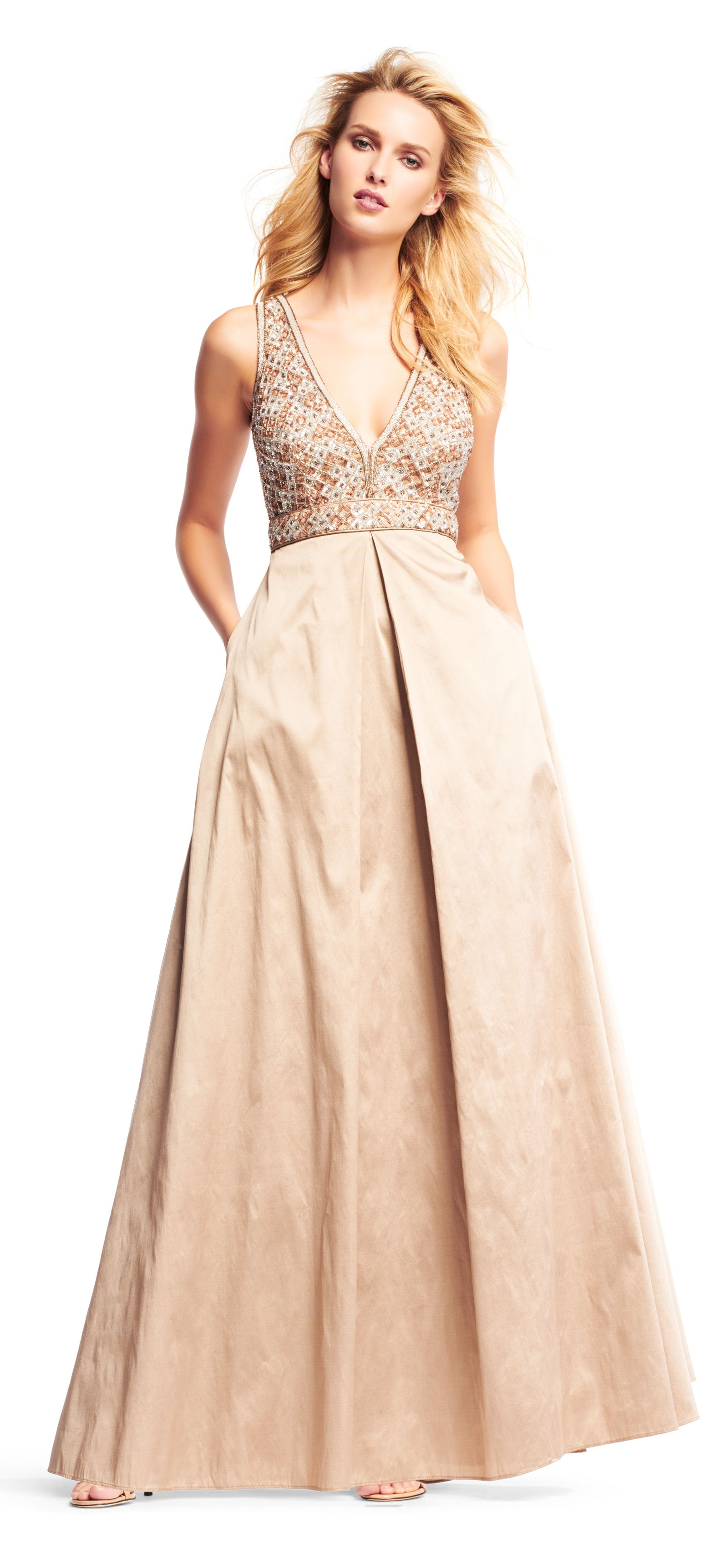 1ecd3edb24 A beaded mesh bodice is the centerpiece of this gorgeous ball gown. This formal  dress features a sleeveless deep v-neck neckline