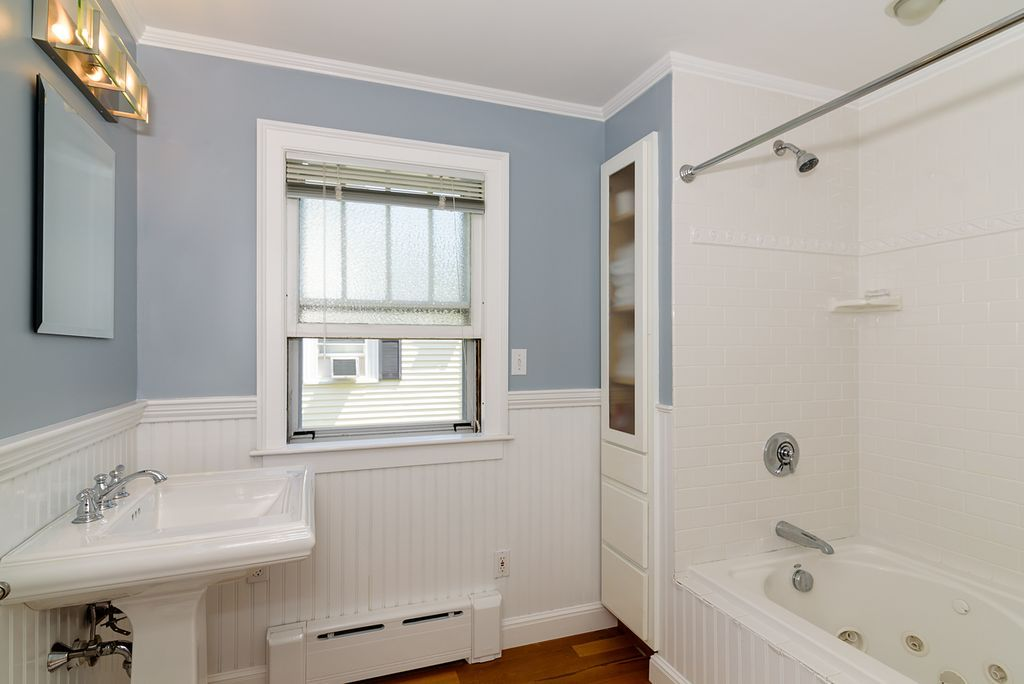 Cottage Full Bathroom With Wainscoting Hardwood Floors DropIn Cool Bathroom Crown Molding