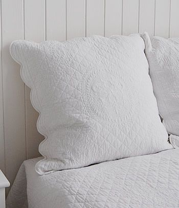 Shows the white pillow sham with feather inner avaialable to purchas with the white bedding