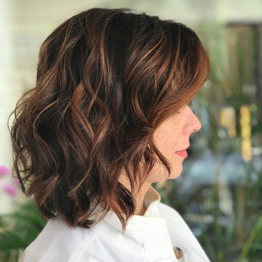 An enchanting brunette medium length bob with auburn highlights #shoulderlengthB…