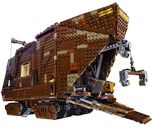 """LEGO Star Wars 75059 Sandcrawler. Includes: Luke Skywalker, Uncle Owen, C-3PO and 4 Jawas, plus R2-D2, R2 unit,R1-series Droid,Gonk Droid,R5-D4,Treadwell Droid Weapons include a light saber for Luke Skywalker,Also includes stock for old droids and droid parts Pretend to suck R2-D2 up into the Sand crawler. New Tank-Tracks. Very satisfying, the """"Steering Wheel"""" that is located on the back works better than you might expect and you can guide this Sandcrawler with ease. toys4mykids.com"""