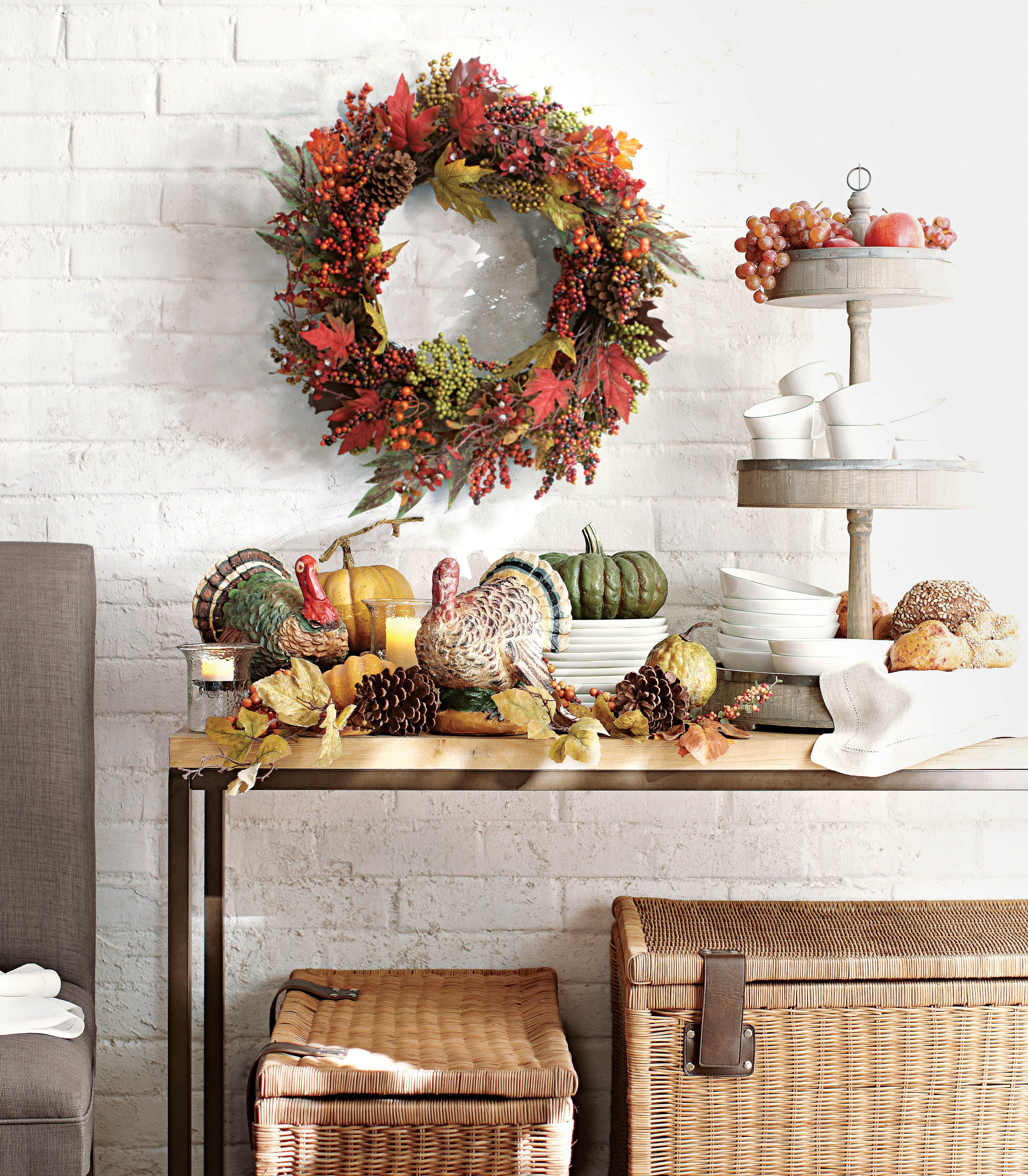 Now this is entertaining... fall style. A gorgeous wreath, pumpkins and fun turkeys are all the decor you need for a fall look. HomeDecorators.com #harvest #entertaining
