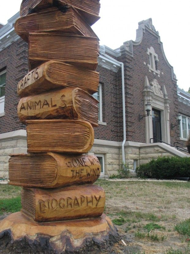 Chain saw artist salvages damaged tree trunks home