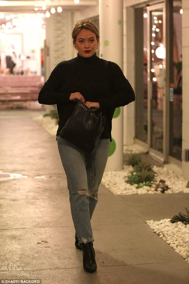 Hilary Duff keeps it casual in black sweater and r