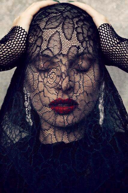 Woman With Black Lace Veil Over Face Red Lipstick Veil Over