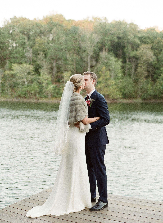 Fall bridal fashion, fur shawl, fingertip length veil, wedding style // Ashley Cox Photography