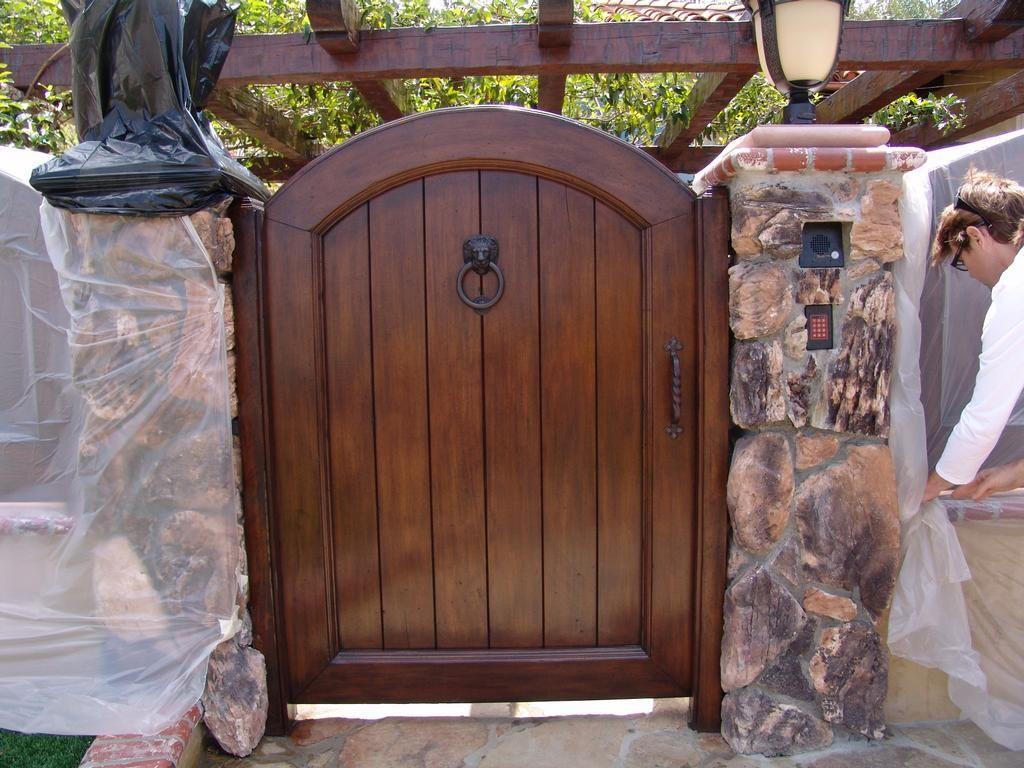exterior wood gates. picture: custom wood gate provided by all star garage door, inc. fresno, exterior gates