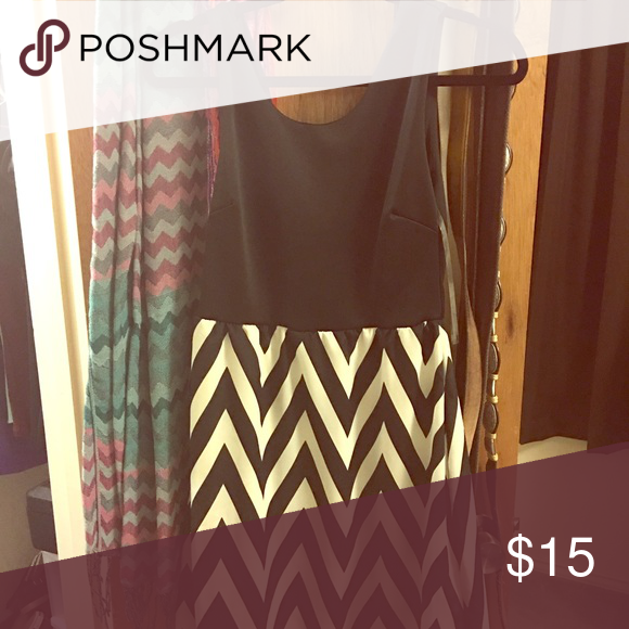 Dress Chevron dress. Black on top and chevron on bottom. Gold zipper on back. Dresses Midi