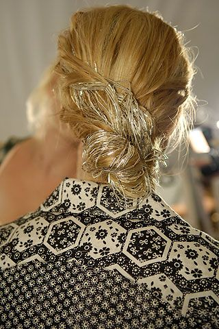 Carolina Herrera s.s '10 // Hairstylist Orlando Pita created simple, low twists decorated with beaded hairpieces. Each one was made of a headband comb with long strands of metallic beads attached.
