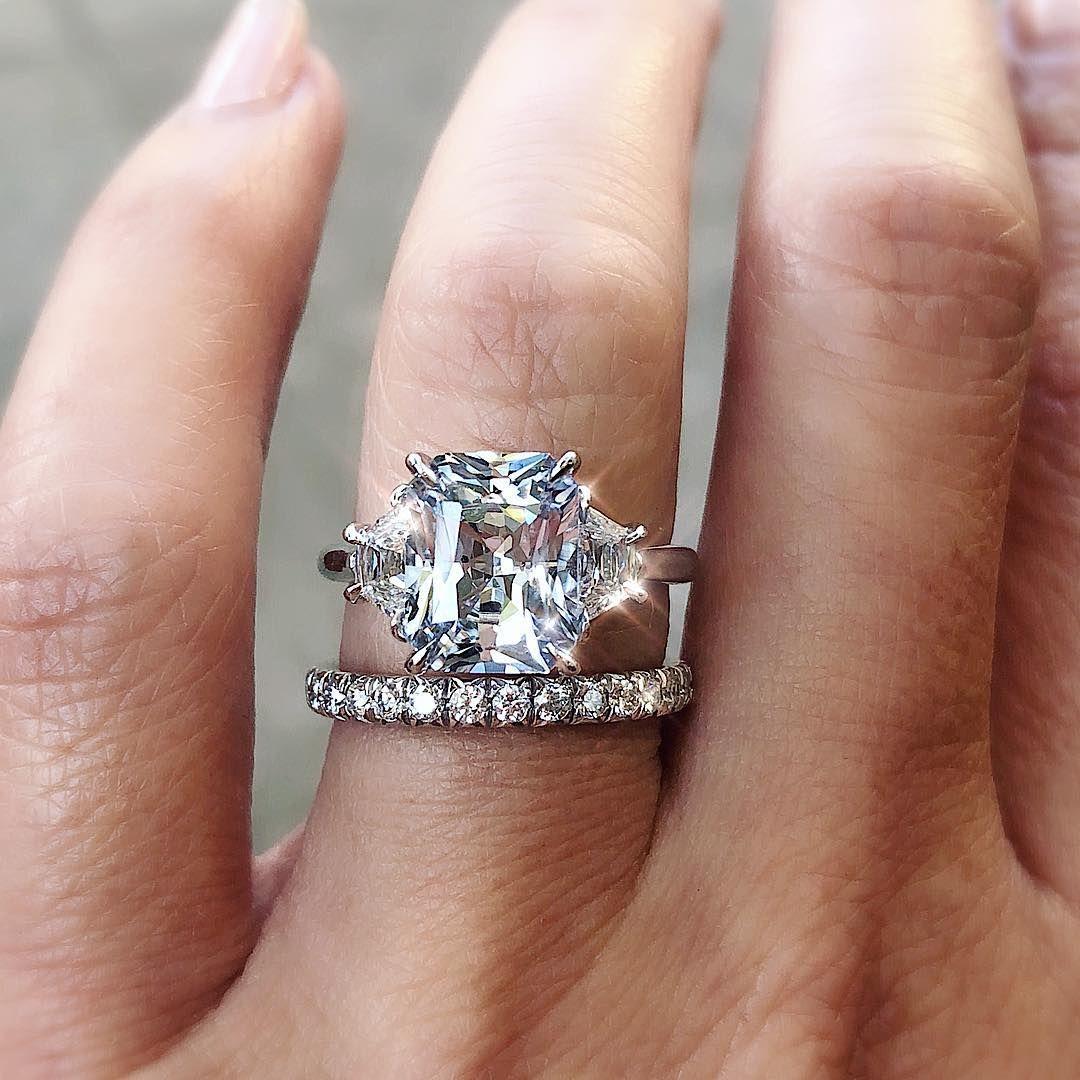6cc00fdd1 3.26ct Radiant Cut pale blue sapphire set with side trapezoid diamonds.😍  trabertgoldsmiths.com
