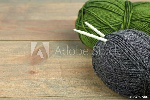 threads for knitting with spokes on wooden brown table