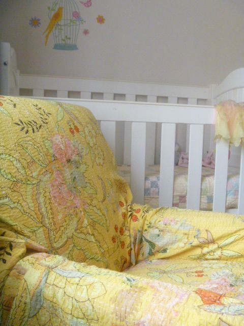 Soft yellows in this toddler's room....with an old chair covered with Deco Flowers Buttercup.