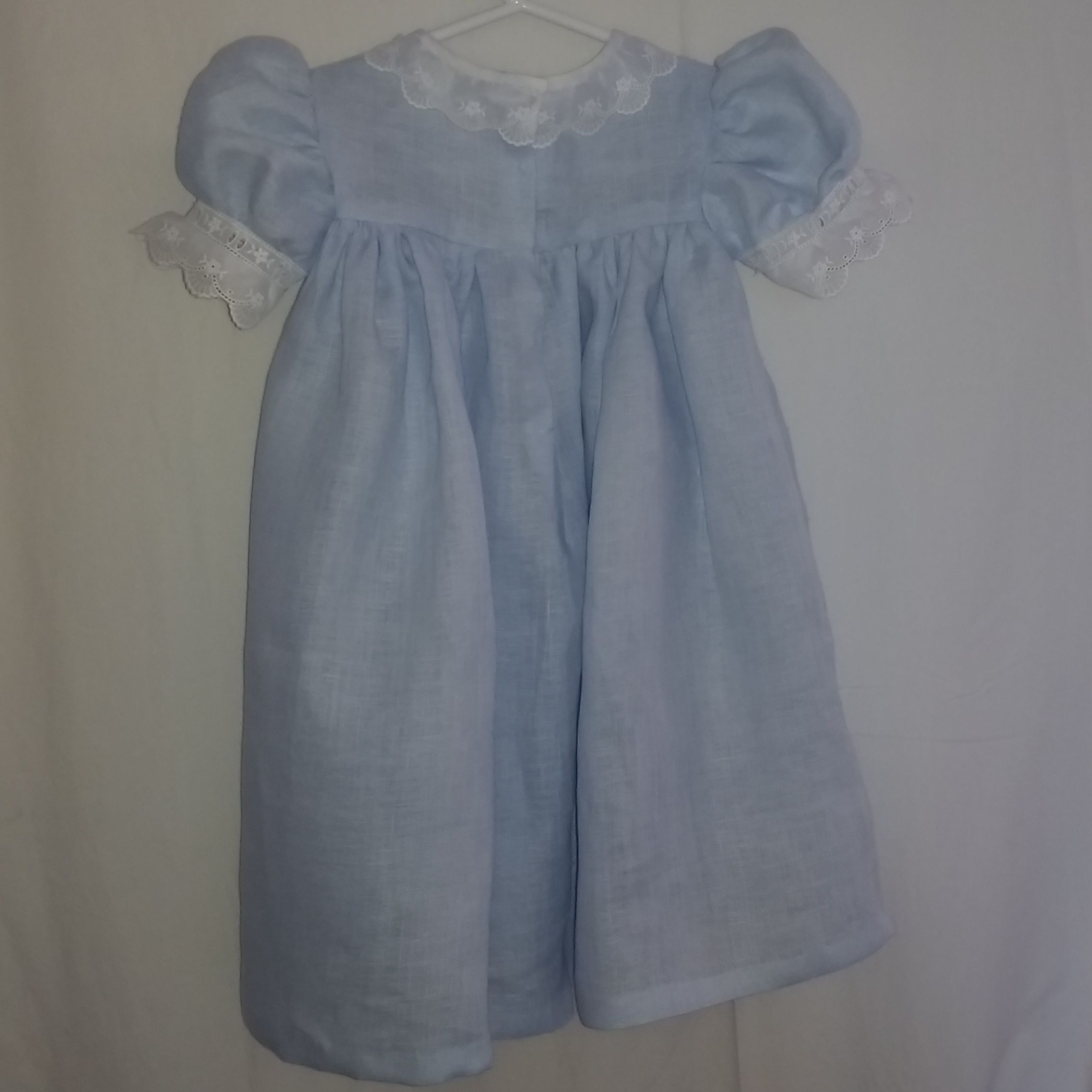 Blue Linen dress w/ white  entredeux, beading fabric (for ribbon insertion, ribbon not included) scalloped collar, puffed sleeves, hand: stitching border, tacking snaps and hem.