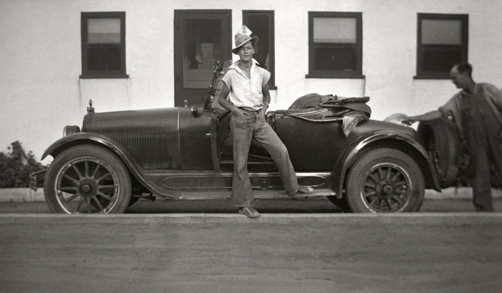 Man stands next to car - ca. 1920s | Old School | Pinterest | 1920s