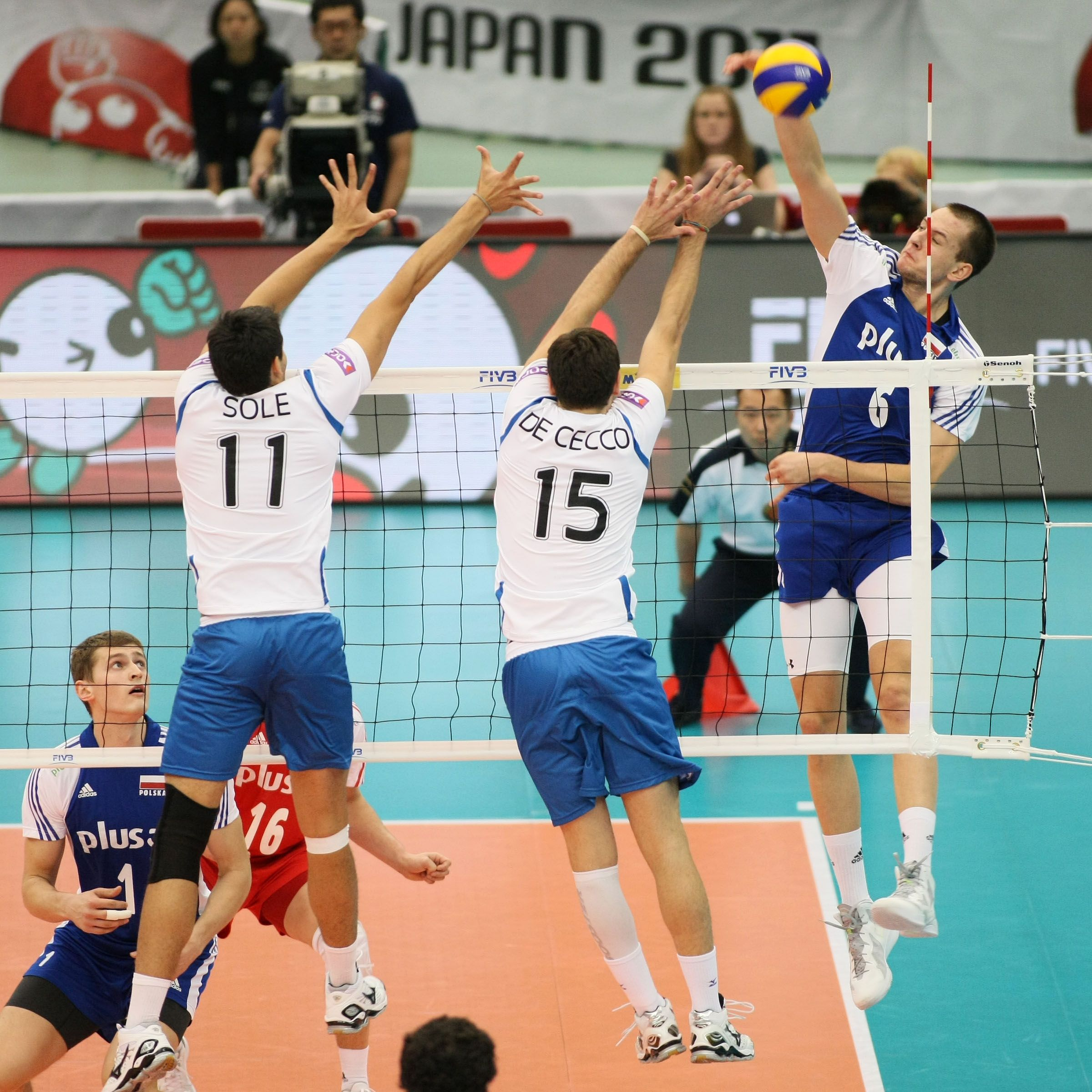 Poland Rising Star Bartosz Kurek Spikes From The Left Wing Against The Argentine Double Block Of Sole Left And De Cecco Argentine