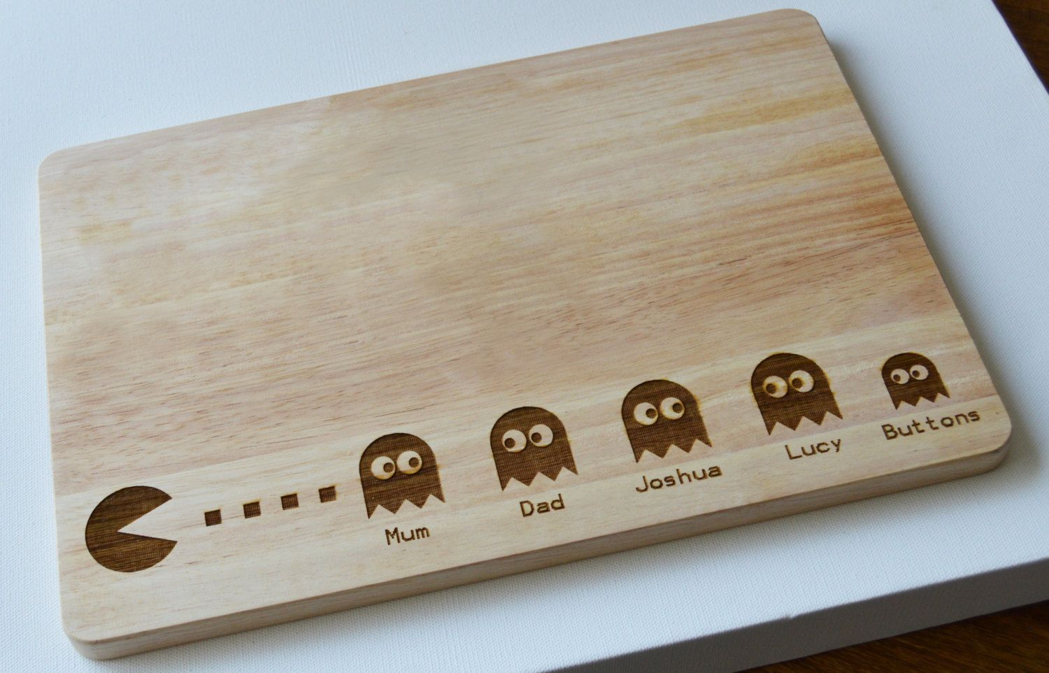 personalised pac man engraved wooden chopping board light wood