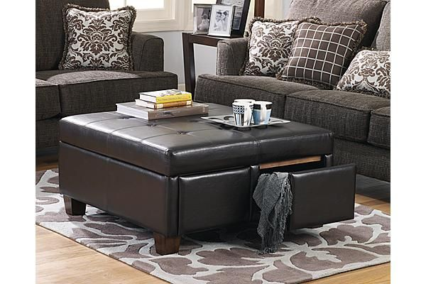 The Torra Brown Ottoman With Storage From Ashley Furniture