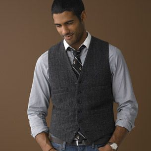 textured vest patterned tie blue jeans fancy/casual