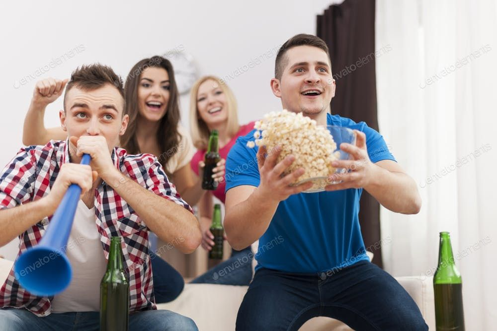 Young group of people celebrating win of favourite sports team By gpointstudios photos