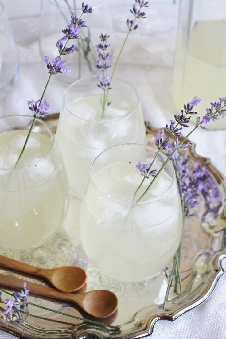 lavender lemonade presentation on silver trays with strong color lavender in drinks.