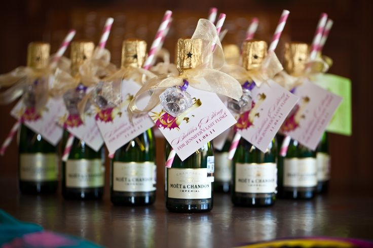 Wedding favors - mini bottles of champagne with paper straw