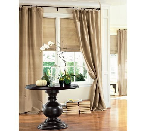 brownstone or blue dawn drapes with grass clothe or tan roman shades for terrace office