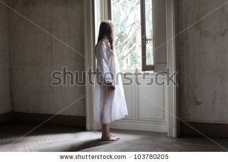 Lonely Beautiful Woman In Night Gown An Empty Room By Ollyy Via ShutterStock