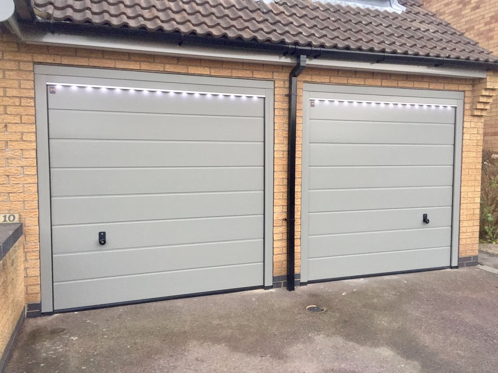 Hormann m rib sectionals silkgrain ral 7030 garage doors cms garage doors photo gallery supplied installed by our own team of fitters including insulated roller shutter sectional side hinged up over doors rubansaba