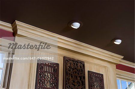 architectural trim dark brown painted ceiling light stained wood trim red walls image. Black Bedroom Furniture Sets. Home Design Ideas