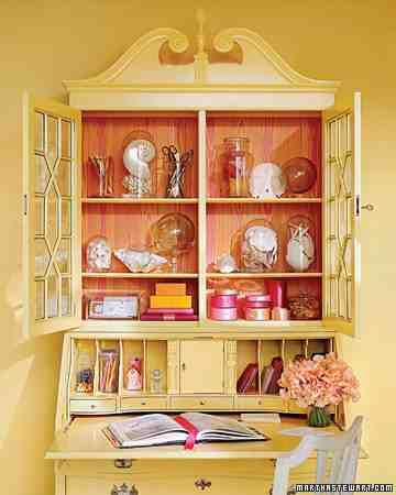This secretary and walls are painted in two close but different tropical shades, and the secretary is lined with a Popsicle-bright faux-bois paper.