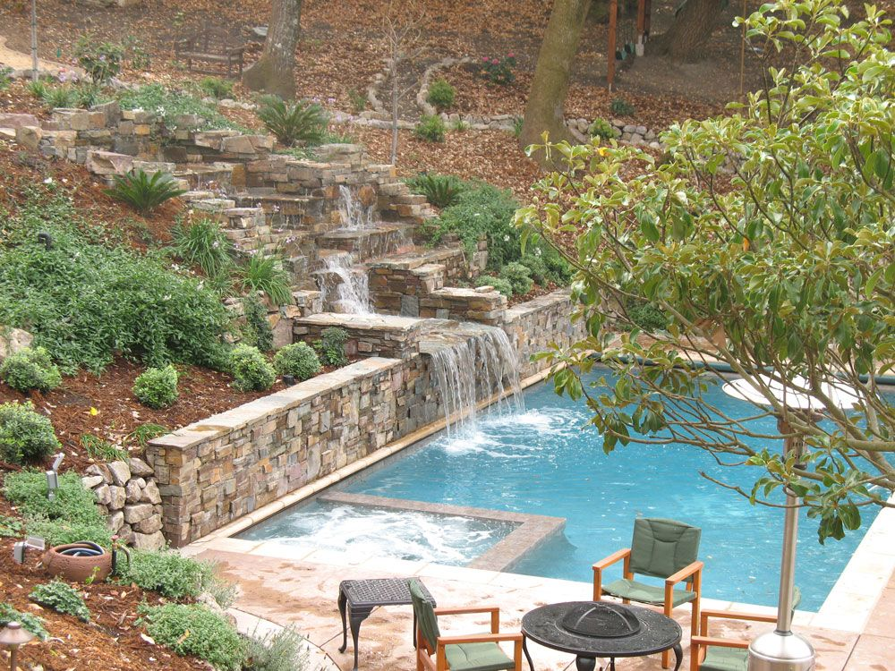 Swimming pool acts as retaining wall google search p o for Pool design hillside