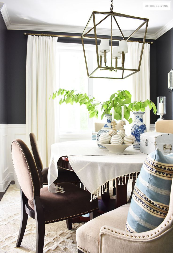 Refined Elegance Black Living Room Set Sophisticated and elegant dining room with transom details. Black walls  painted in Cracked pepper by Behr Paint. Neutral decor with layers of blue  and white ...