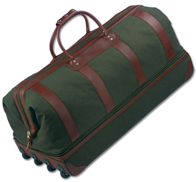 Made of our popular, rugged, and handsome 18-oz. cotton canvas. Use the top compartment as a big, spacious duffle and the reinforced bottom to haul sporting gear or to keep pressed clothes neat. With durable web pull handle and built-in protected wheels. Leather luggage tag included.