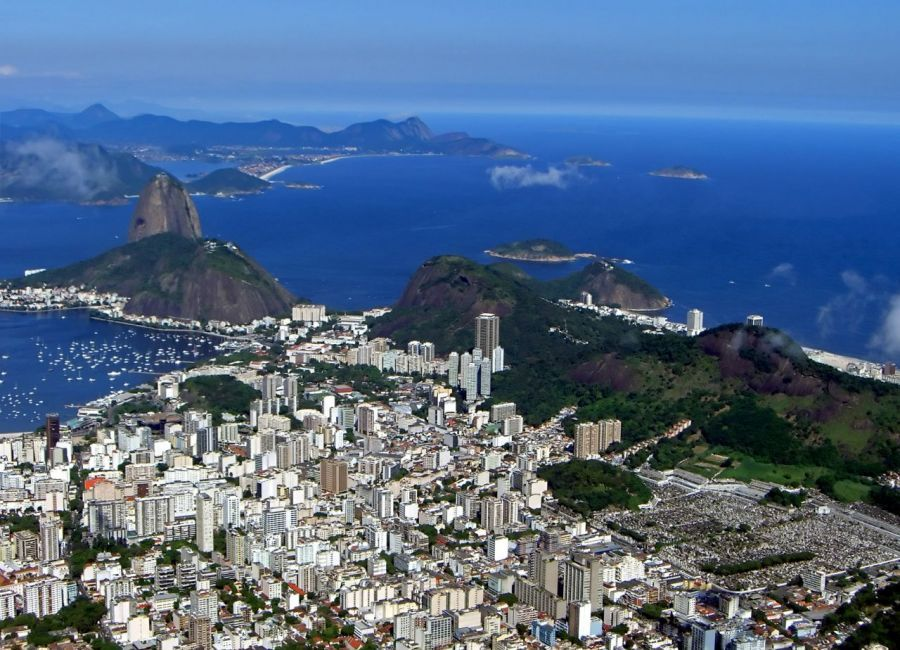 Sweeping shot of #Rio from the top of #Corcodova Mountain looking out to #SugarLoaf Mountain and the rest of the city. #Brazil | Picfari.com