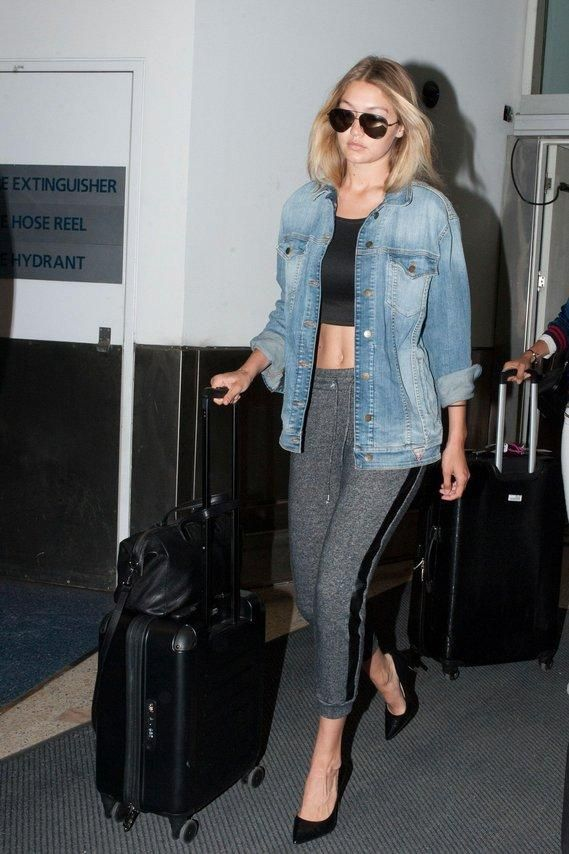 Gigi Hadid just turned your comfy netflix outfit of sweats and a tank into the perfect airport look