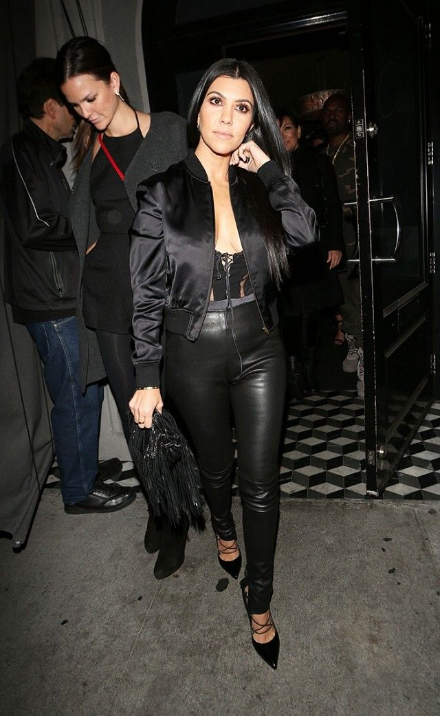 Kourtney Kardashian wears the perfect GNO look in leather skinnies and a silk black bomber jacket.