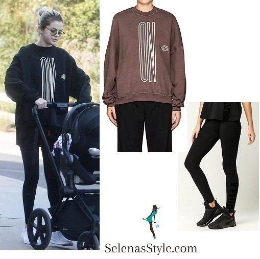 6c769bad7b54 Selena Gomez style fashion outfit clothes black On Earth sweatshirt black  Puma leggings baby buggy December 2017