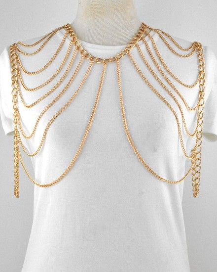 Gold colored body jewelry worn around the neck and shoulders