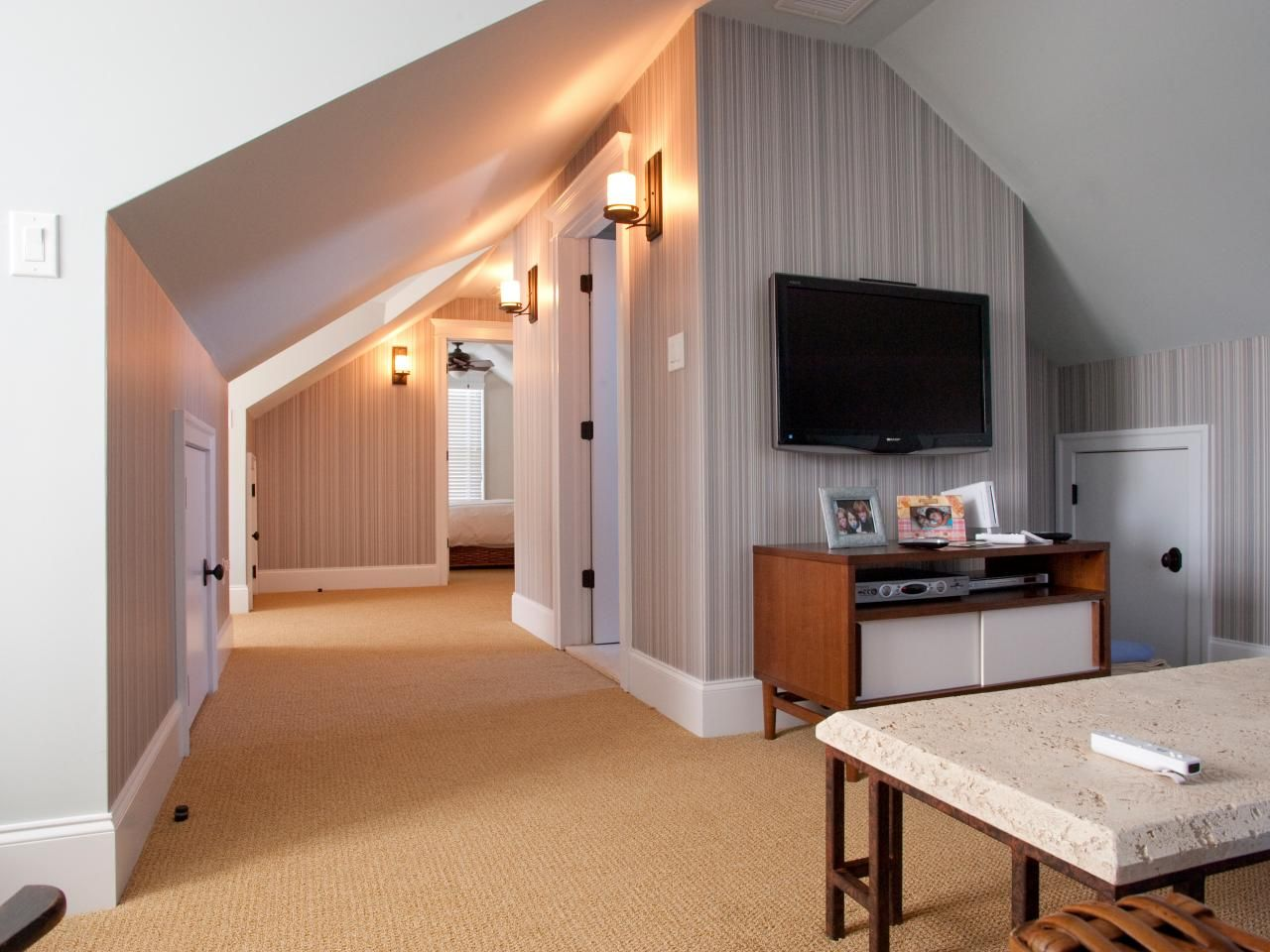 A Media Room Is Set Up In This Attic Space Complete With A Flat Screen Television Modern Media Cabinet And Te Attic Master Bedroom Attic Remodel Attic Design
