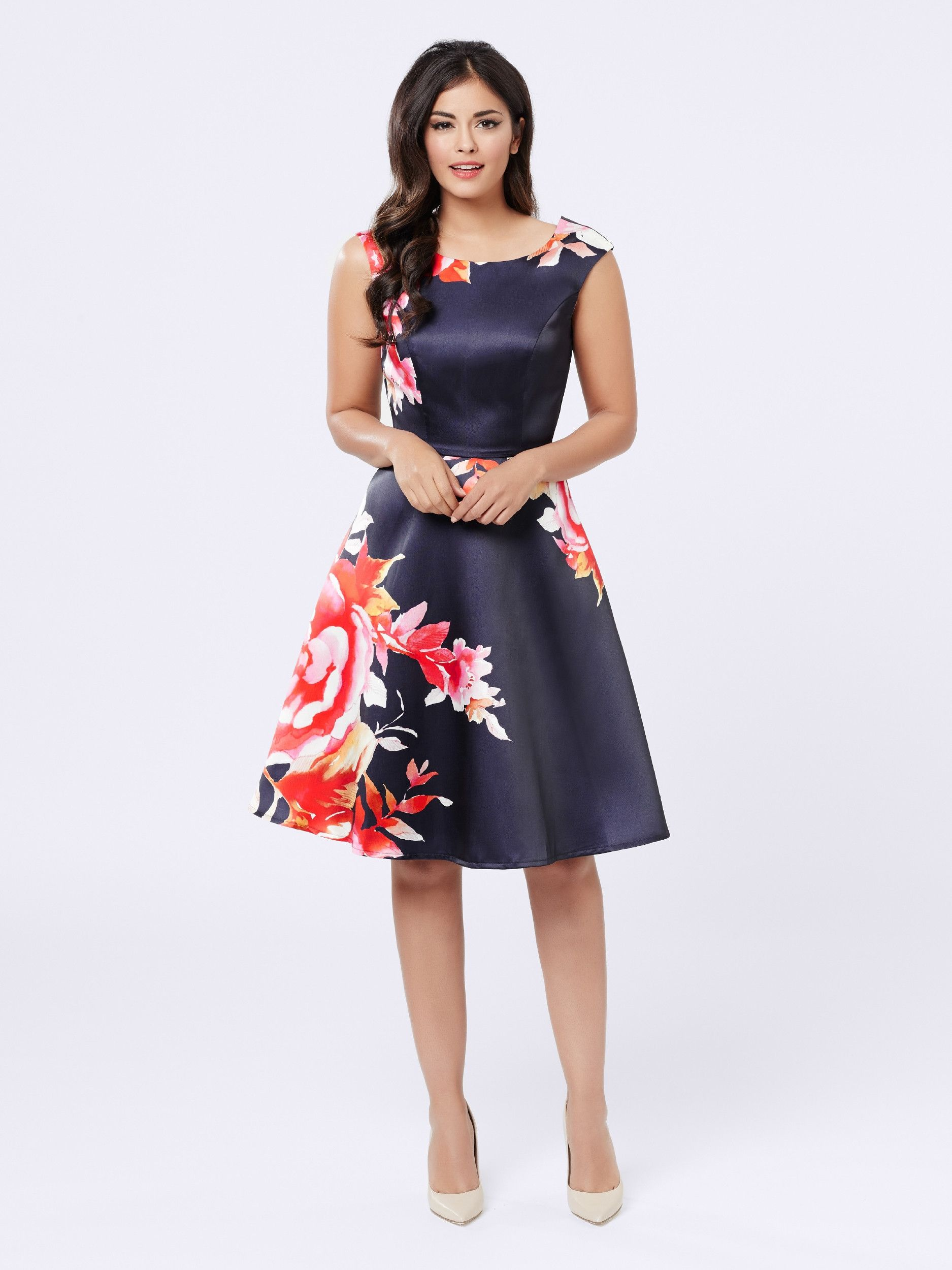 Turn Heads In The Beautiful Bloom Dress In Navy With A
