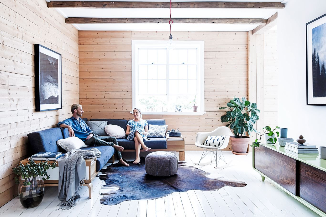 """A key living room feature is the pine wall, laid horizontally. """"A ..."""