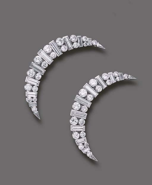 A PAIR OF DIAMOND HAIR SLIDES, BY CARTIER   Each designed as a circular and baguette-cut diamond crescent, mounted in platinum, circa 1937