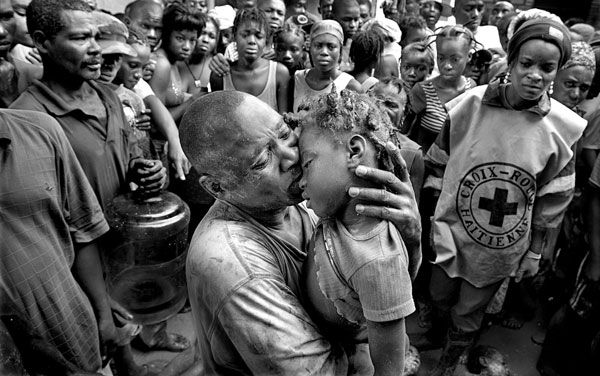 Frantz Samedi holds his lifeless 5-year-old daughter, Tamasha Jean, who died when Hurricane Ike's flood waters swept children and the elderly from their homes in the small Haitian town of Cabaret in this Sept. 7, 2008 photo. This photo is one from a series from the 2009 Pulitzer Prize for Breaking News by Miami Herald photographer Patrick Farrell.