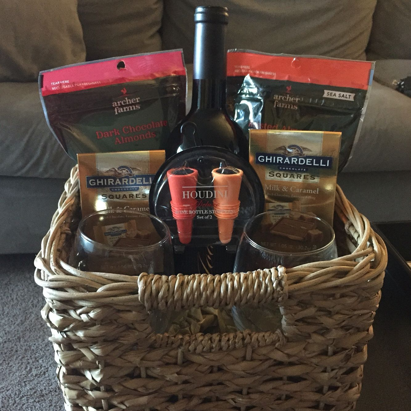 wine basket includes stemless wine glasses wine bottle almonds chocolate goodies bottle stoppers